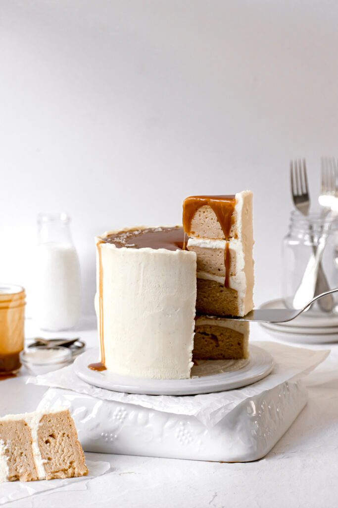 caramel layer cake with slice being taken out