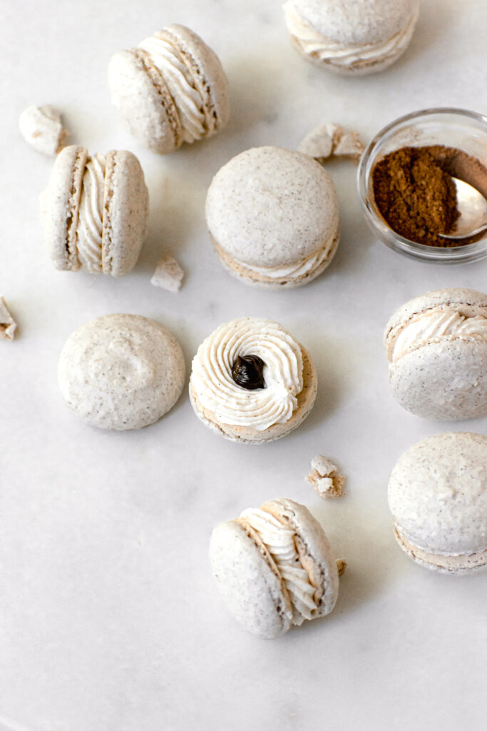 Chai Spiced Macarons with Swiss Meringue Buttercream and Chocolate Ganache on marble