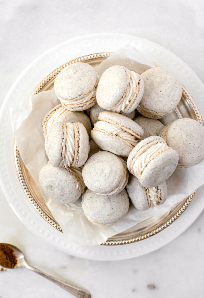 chai macarons in parchment lined gold bowl