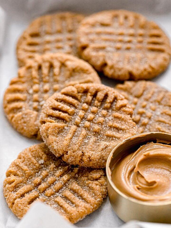 flourless peanut butter cookies piled in small baking sheet