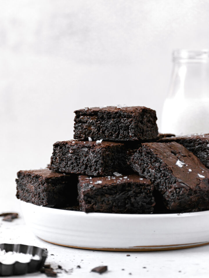 brown butter brownies piled on white plate