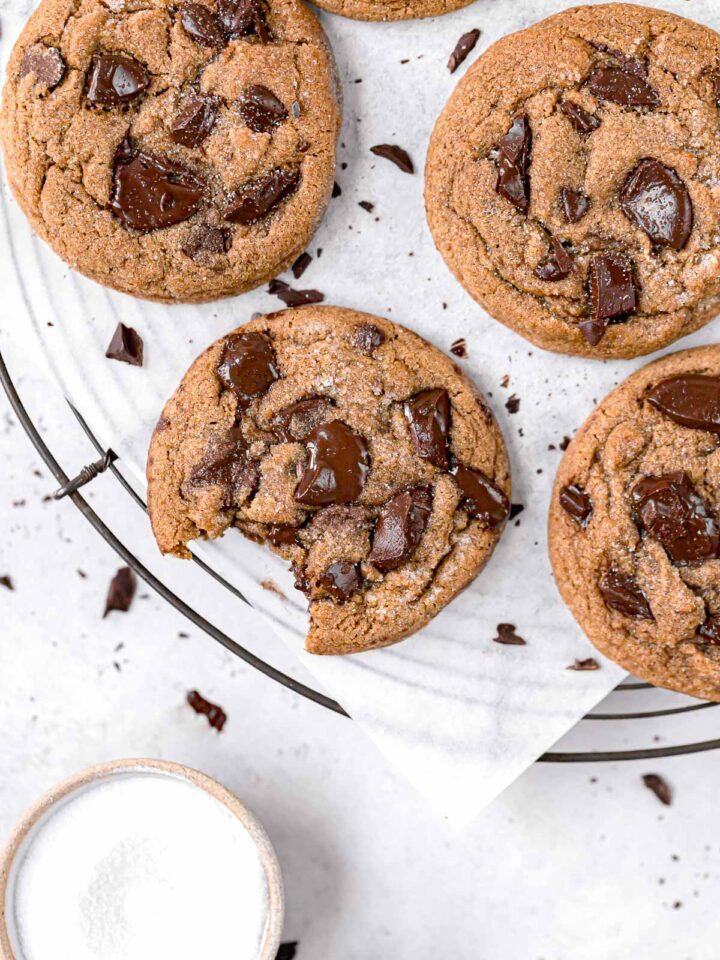 chocolate chip molasses cookies on round wire rack