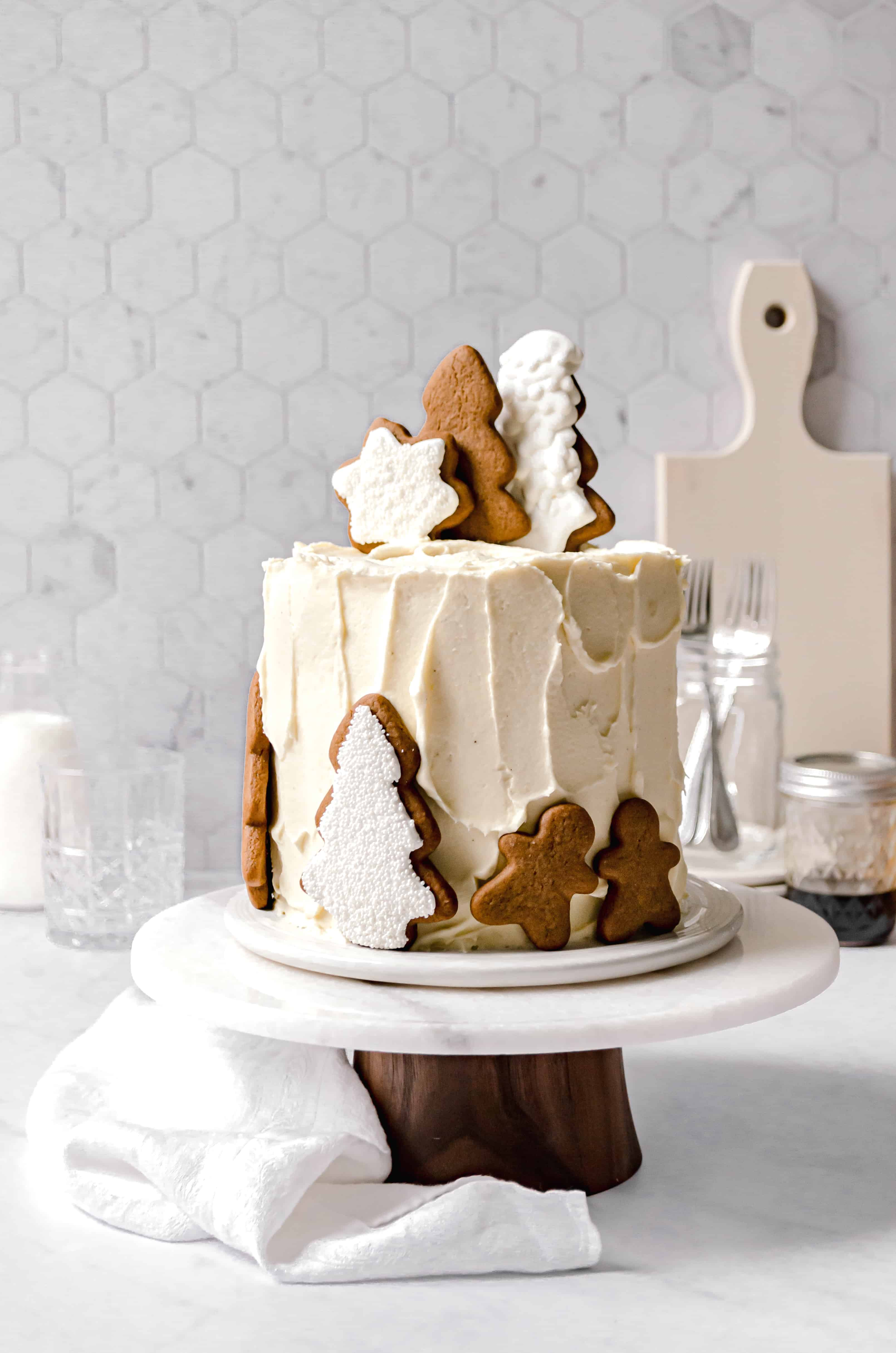 gingerbread layer cake with gingerbread cookies on top
