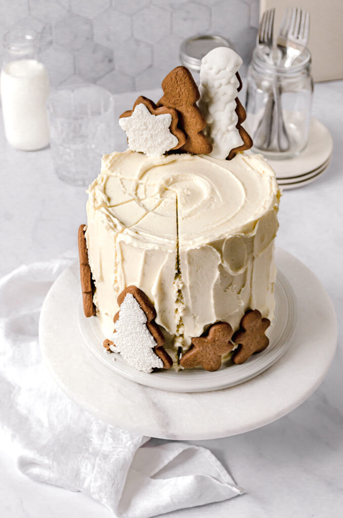 sliced cake with cutout cookies on top