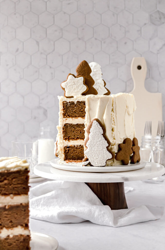 sliced gingerbread layer cake with gingerbread cookies on top