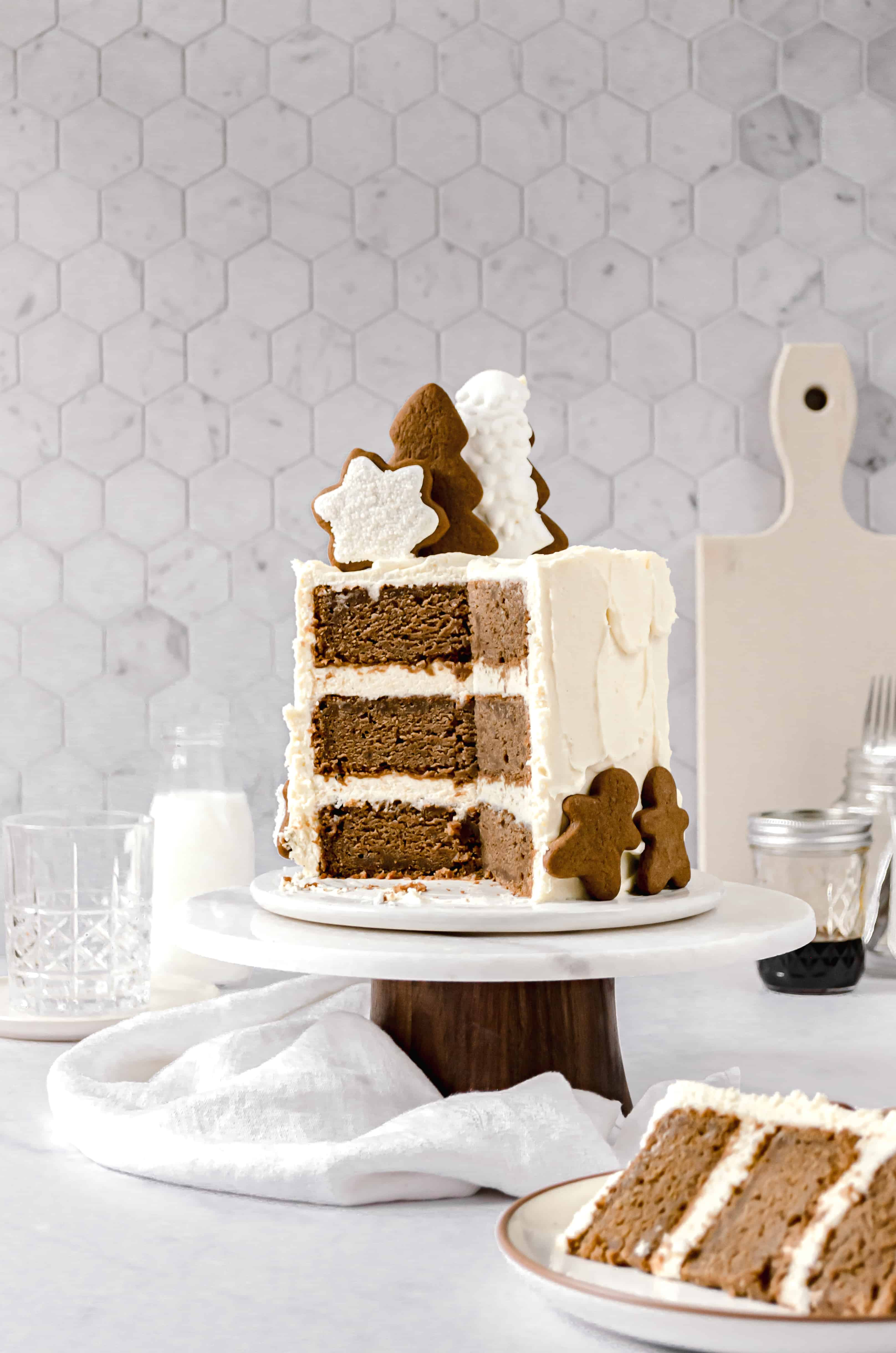 cut gingerbread layer cake on cake stand