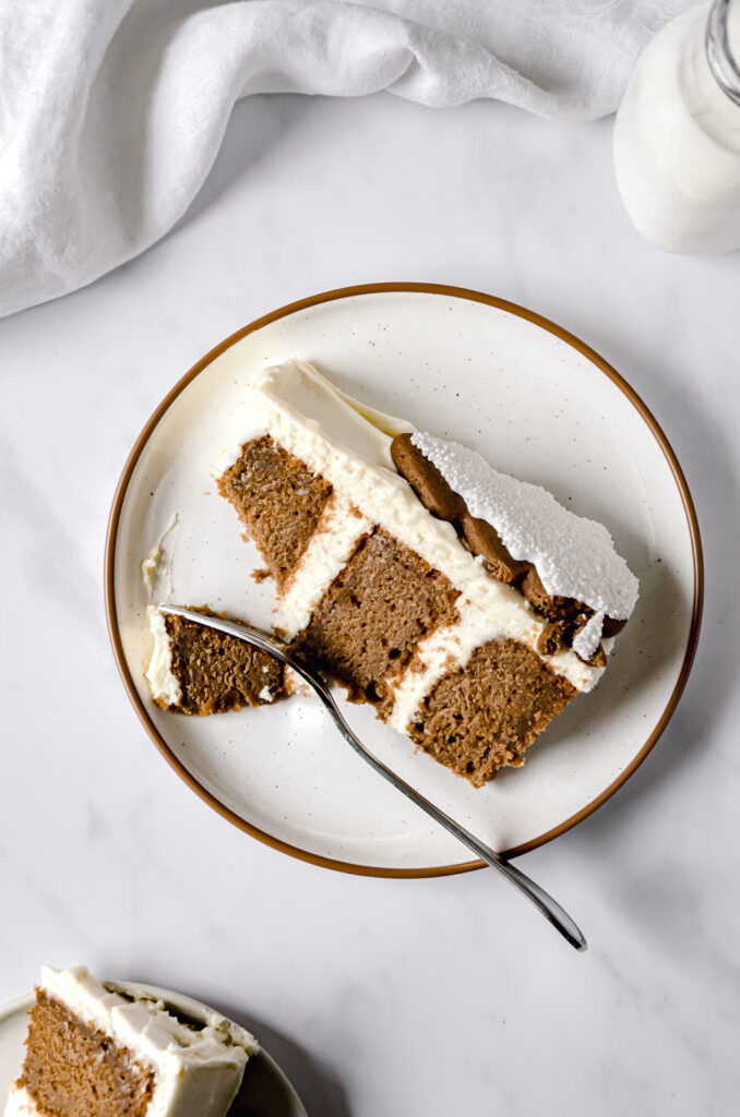 one slice of gingerbread layer cake on white plate with fork