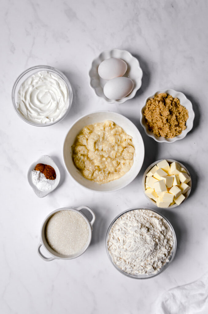 ingredients for cake laid out on marble in separate bowls