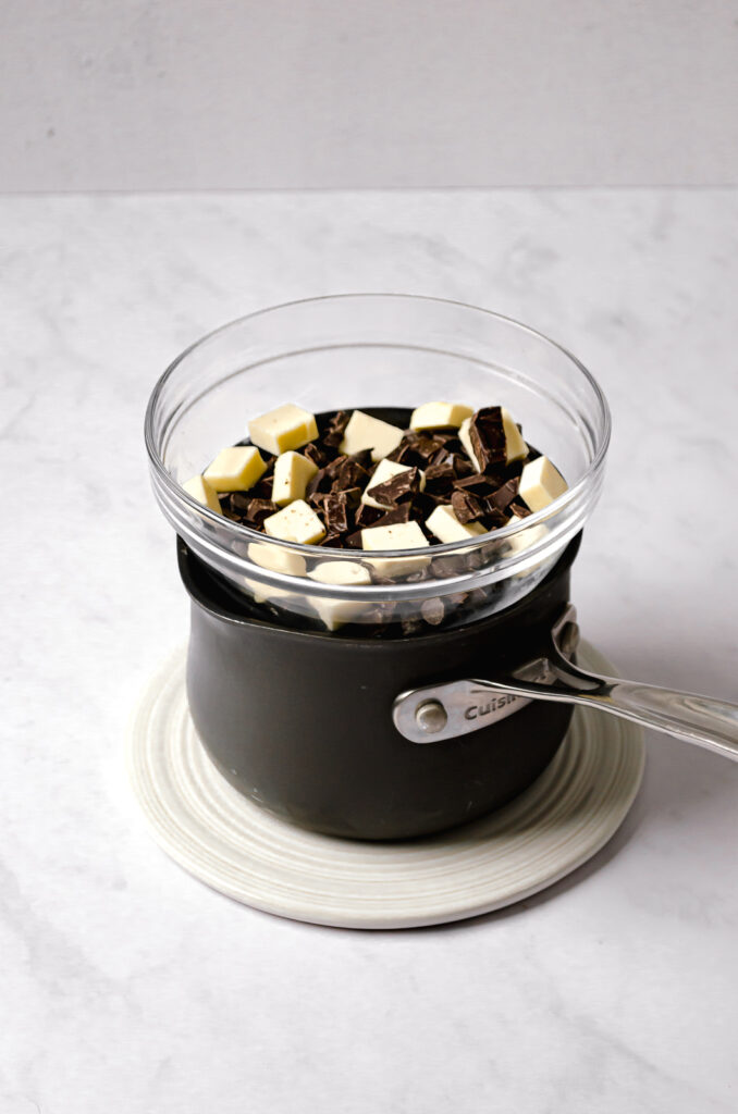 chocolate and butter in glass bowl over double boiler