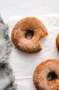 buttermilk cinnamon sugar donuts on parchment paper