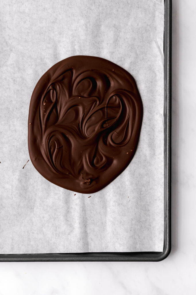 solid chocolate on parchment lined baking sheet