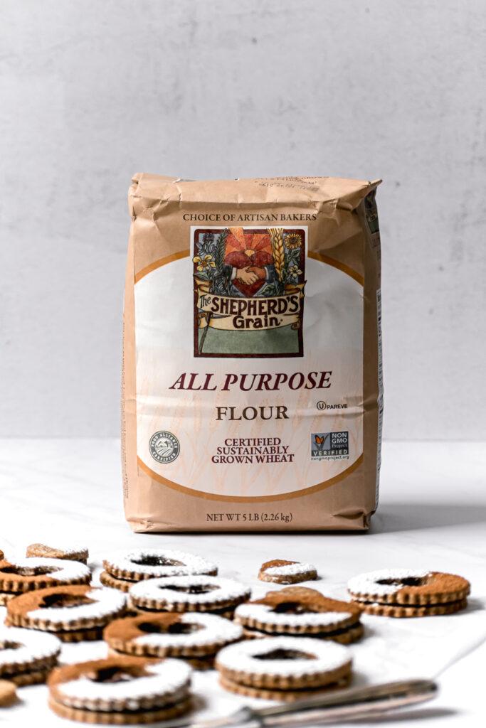 bag of shepherd's grain flour with linzer cookies