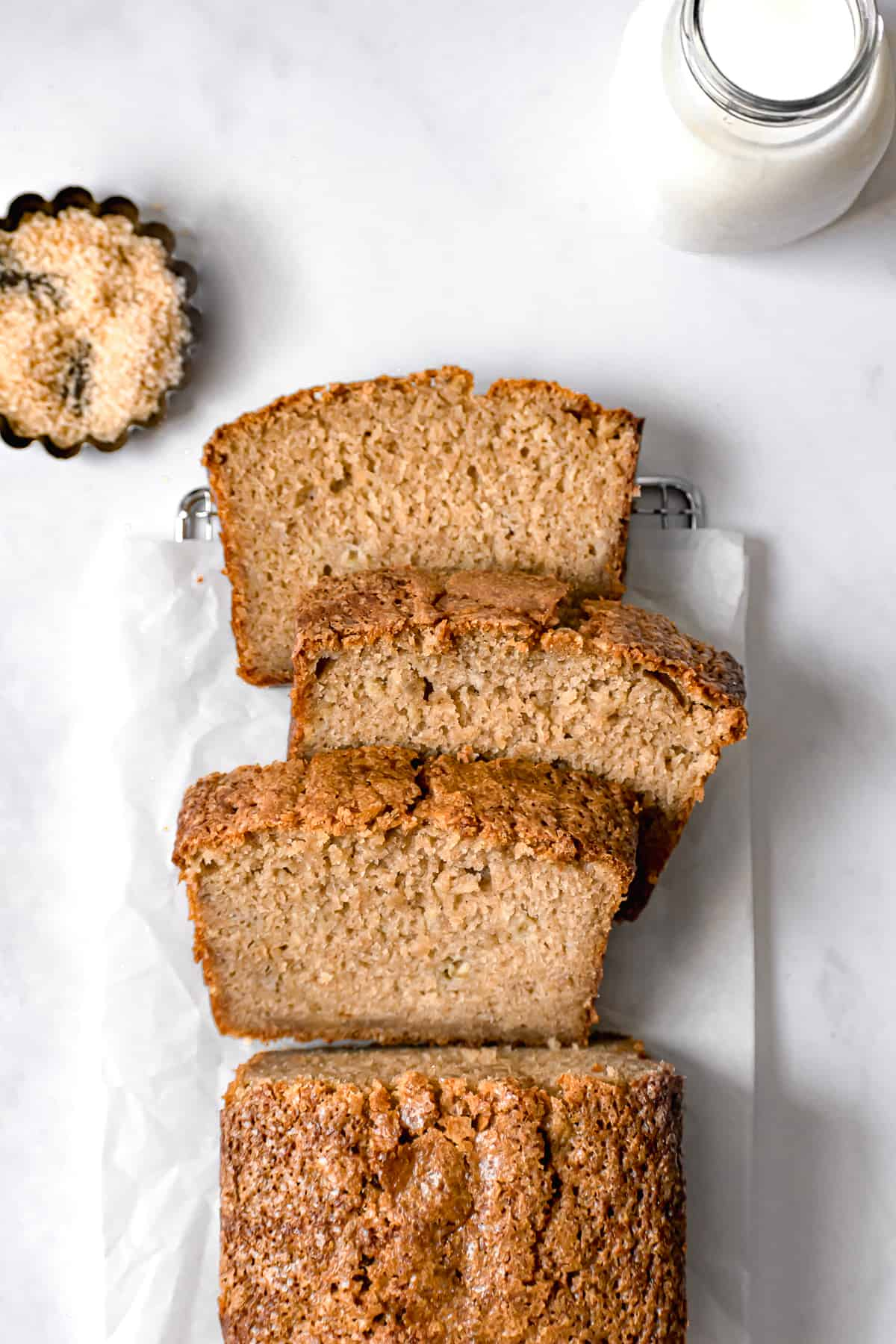 sliced brown butter banana bread on parchment paper