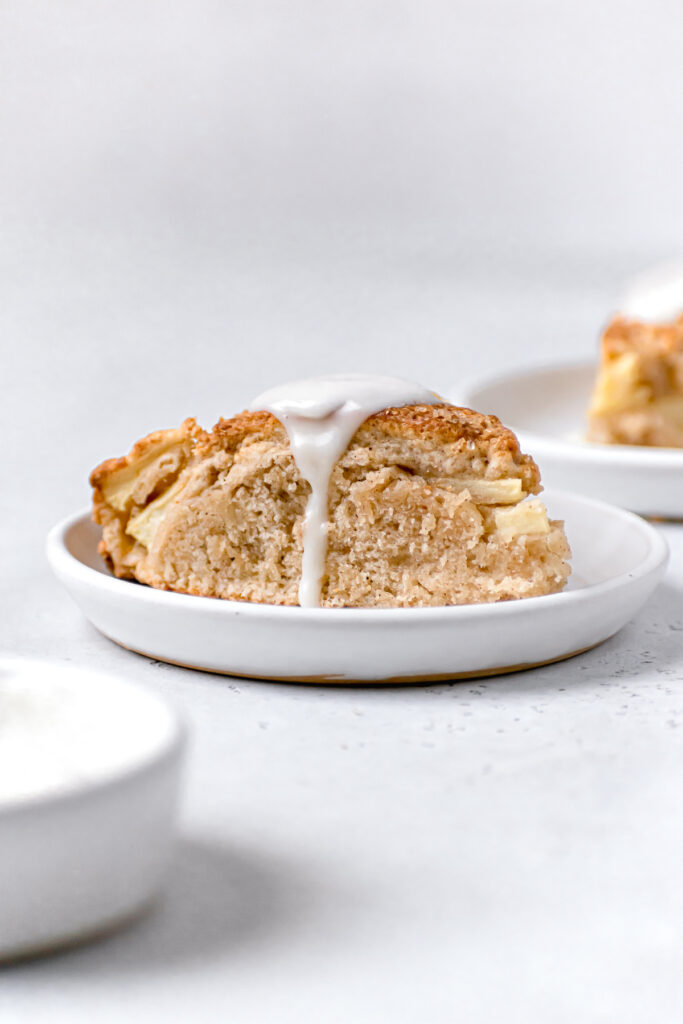 one apple cinnamon scone on white plate to show soft interior