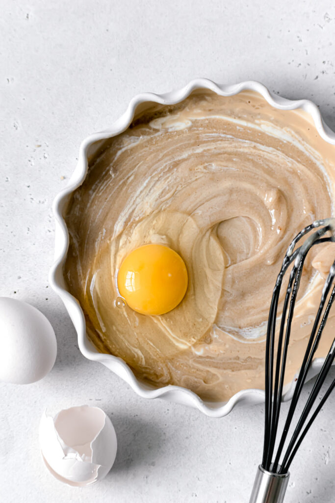 egg being whisked into wet ingredients