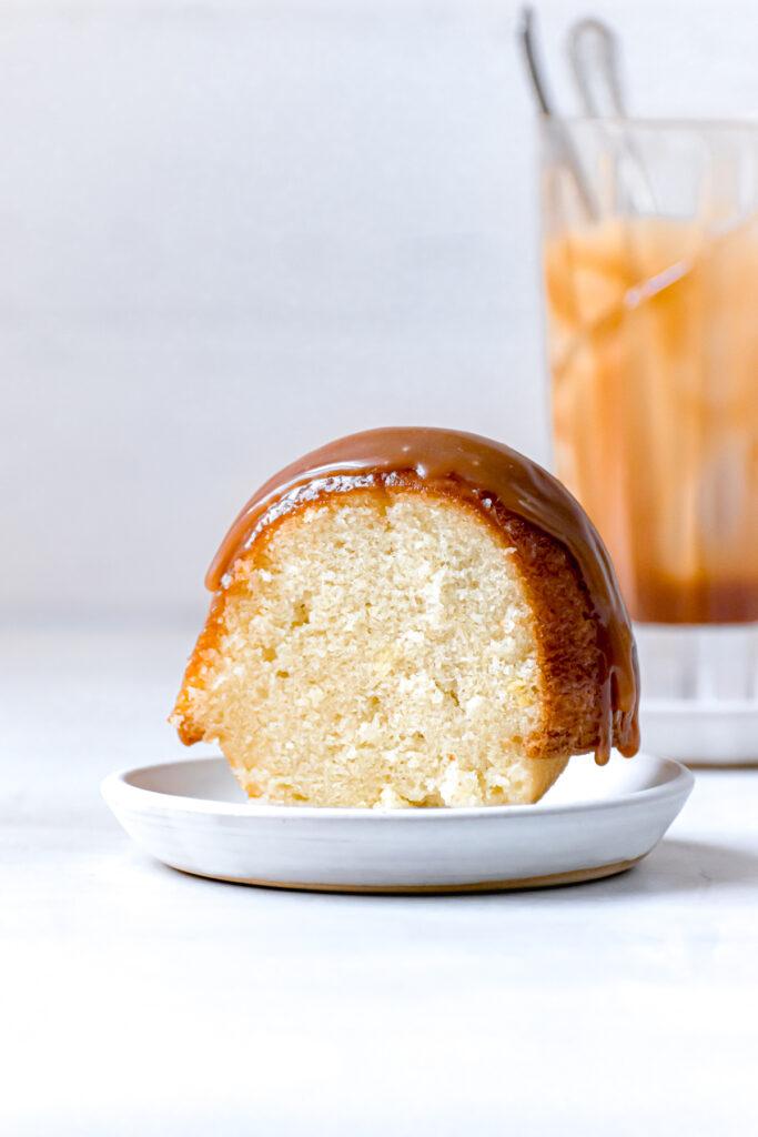 one slice of caramel rum bundt cake on white plate