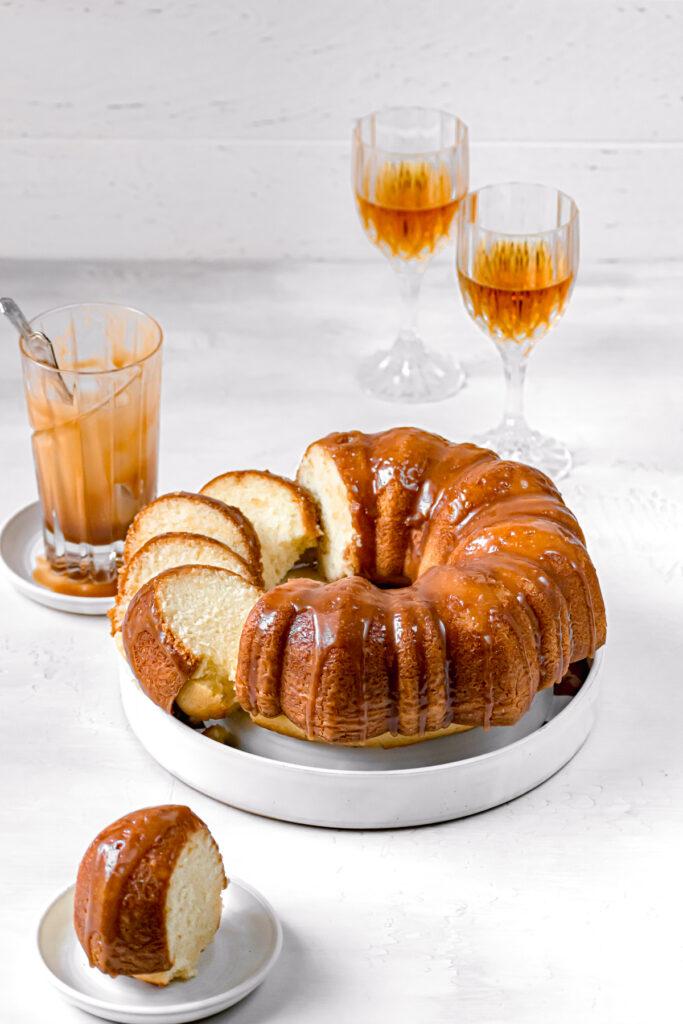 sliced caramel rum bundt cake on white plate