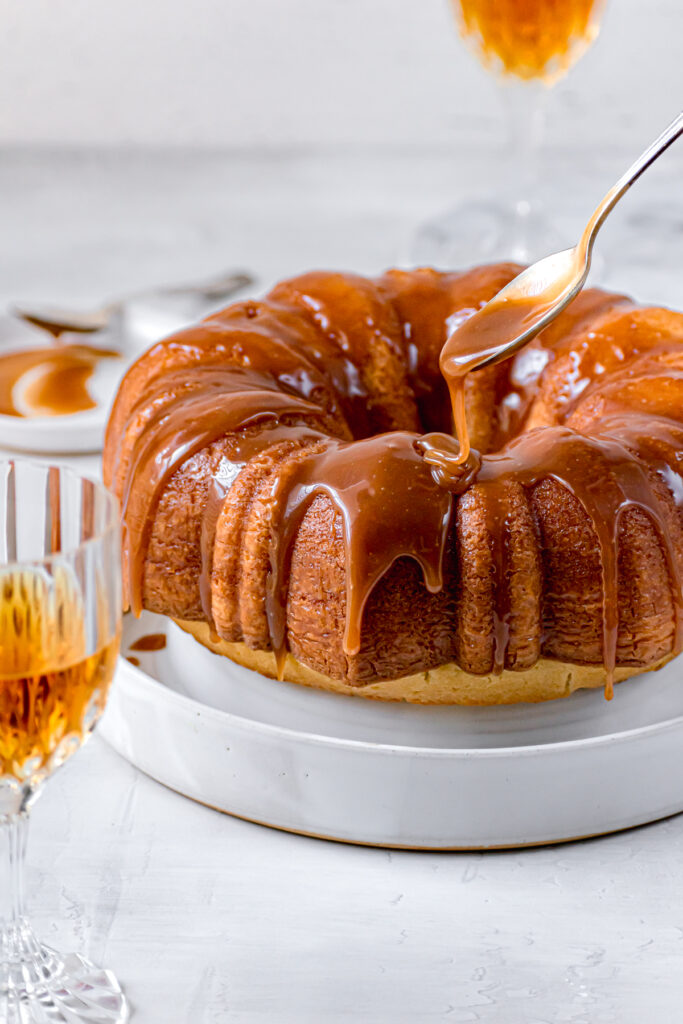 caramel sauce being drizzled on bundt cake
