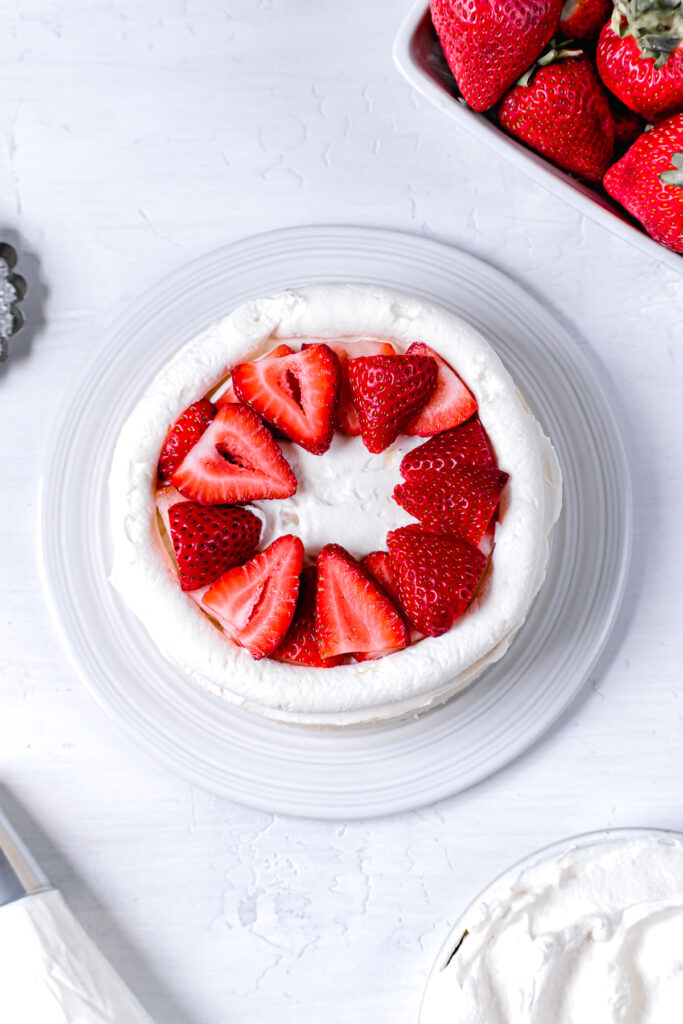 sliced strawberries layered in the middle of the cake