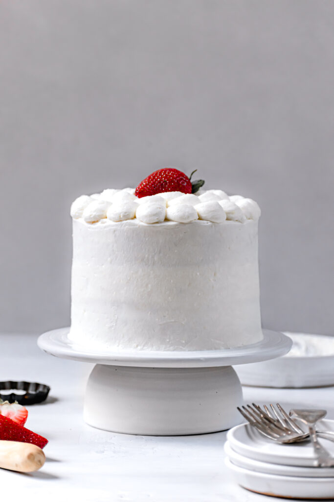 decorated cake on white cake stand