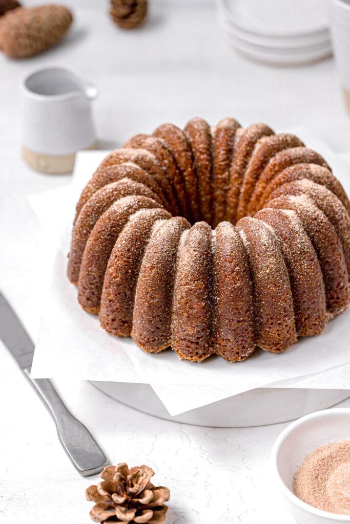 apple cider bundt cake covered in cinnamon sugar