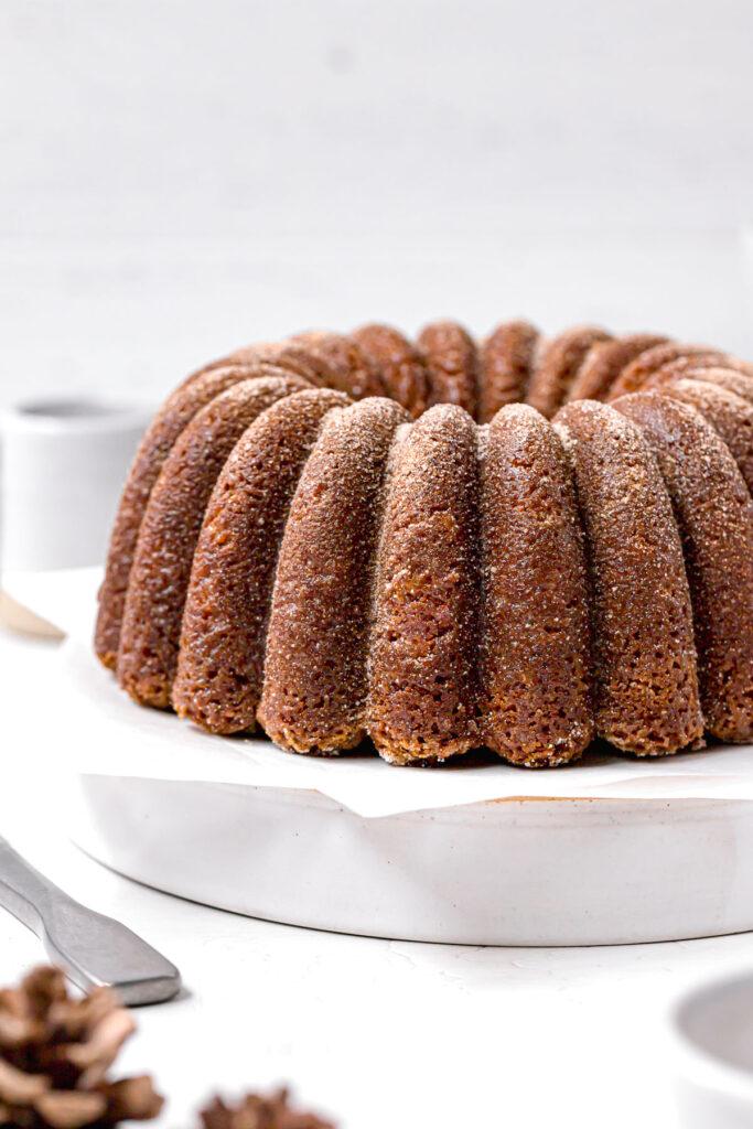 apple cinder bundt cake on white plate