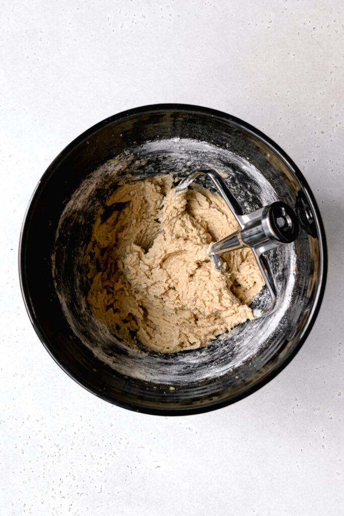 cookie dough in black mixing bowl