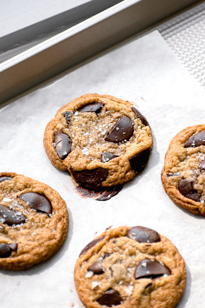 gluten free chocolate chip cookies on parchment lined baking sheet