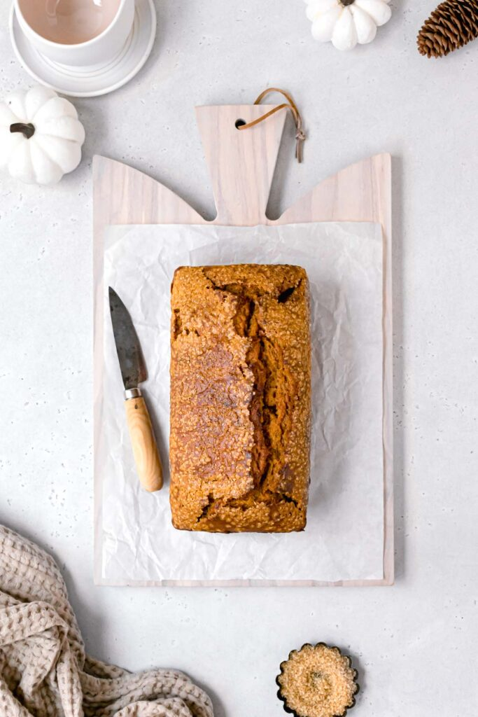 whole pumpkin bread loaf on cutting board