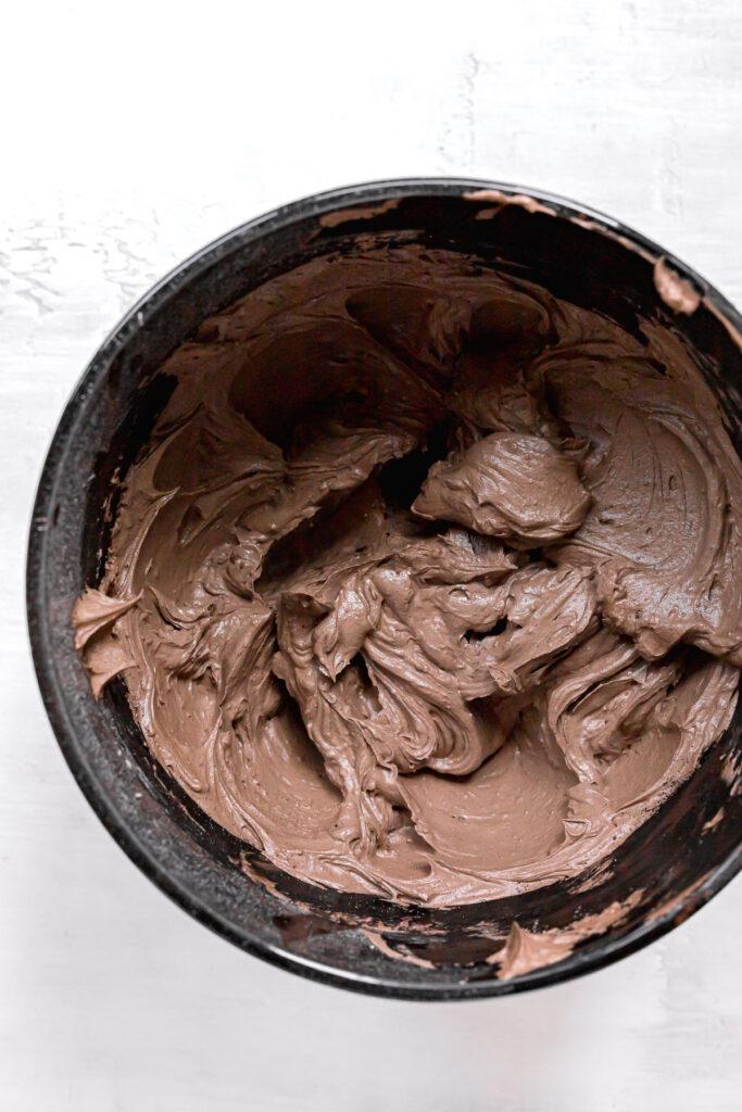 black cocoa frosting in black bowl